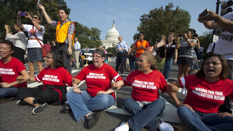 Women link arms and sit in a circle in Washington