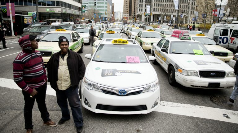 Taxi and Uber's black car service drivers protest the ride-hailing services Uber X and Lyft in December. The drivers are protesting that Uber and Lyft are operating without legal approval in the city. (AP Photo/Matt Rourke)