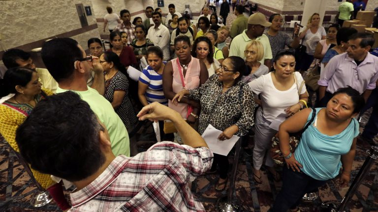 Displaced casino workers wait to enter a room to sign up for unemployment at the Atlantic City Convention Center in Atlantic City last week. (Mel Evans/AP photo)