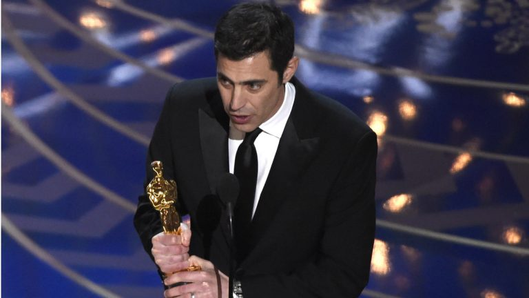 "Josh Singer accepts the award for best original screenplay for ""Spotlight"" at the Oscars last month. (Photo by Chris Pizzello/Invision/AP)"