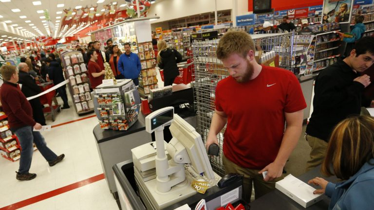 A cashier checks out a shopper buying several iPads on Thanksgiving last year at a Target store in Colorado. Efforts by employees of the Deptford Mall to keep the South Jersey mall closed on Thanksgiving have not succeeded. (AP file photo)