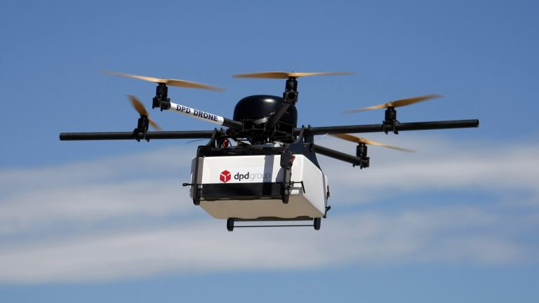 A DPD Geopost prototype drone  carrying a parcel flies during a test flight in Pourrieres, southern France, in June. GeoPost, a package delivery subsidiary of LaPoste, is set to launch a program which will see parcels delivered by drones. The GeoDrone completed its first successful automated flight last September. (AP Photo/Claude Paris)