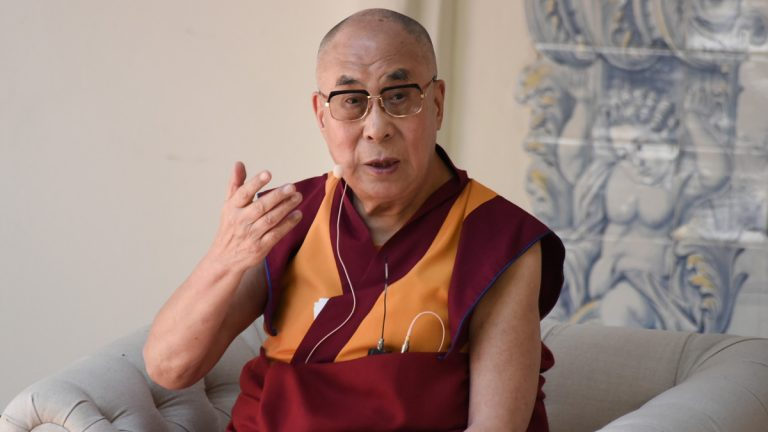 His Holiness the 14th Dalai Lama speaks on stage during the Peak Mind Foundation celebration at Rancho Las Lomas in July at Silverado, California. The Dalai Lama will visit Philadelphia in October. (Photo by Richard Shotwell/Invision/AP)