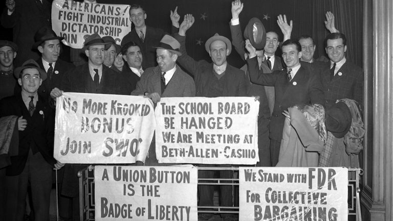 Employes of the Bethlehem Steel Company's plant display signs they carried at a rally at Bethlehem
