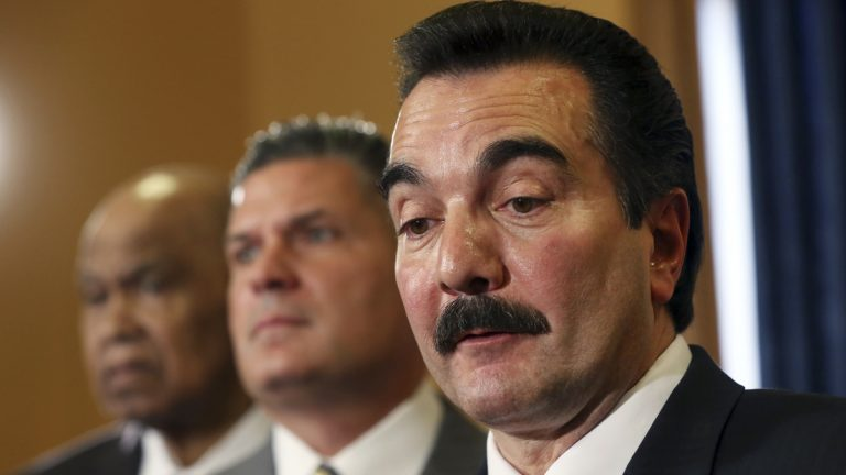 New Jersey Assembly Speaker Vinnie Prieto, right, says the gas tax must be raised to replenish the fund that pays for road and bridge repairs and maintenance. (AP photo/Mel Evans)