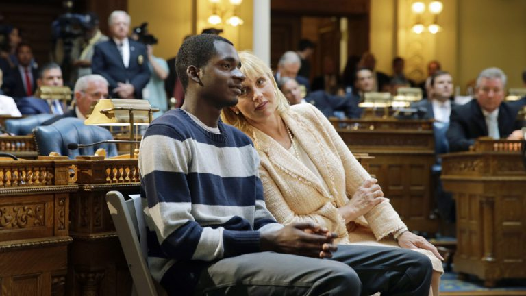 New Jersey Lt. Gov. Kim Guadagno talks with Iquan Small