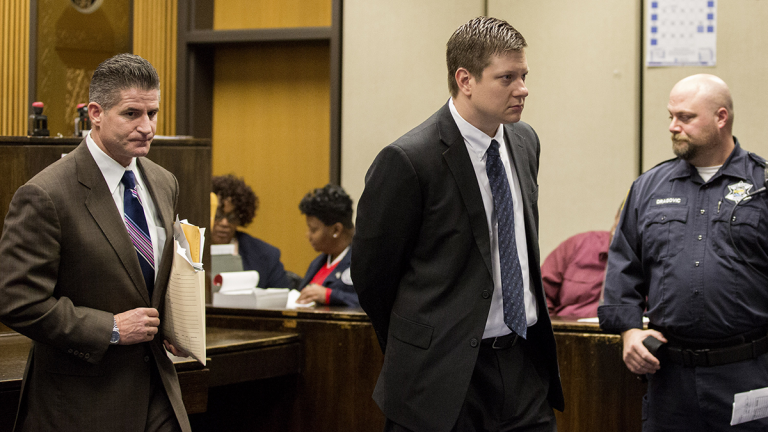 Chicago police Officer Jason Van Dyke, center, leaves the courtroom after a hearing, with his attorney, Daniel Herbert, at the Leighton Criminal Court Building in Chicago, Friday, Dec. 18, 2015. It was Van Dyke's first appearance in court since a grand jury indicted him on Wednesday, Dec. 16. He faces six counts of first-degree murder and one of official misconduct in the 2014 shooting death of 17-year-old Laquan McDonald. (Zbigniew Bzdak/Chicago Tribune via AP, Pool)