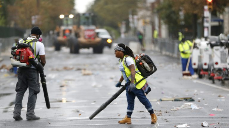 Workers use blowers during the cleanup process along Benjamin Franklin Parkway in Philadelphia a day after Pope Francis concluded his 10-day trip to Cuba and the United States. (Julio Cortez/AP Photo)