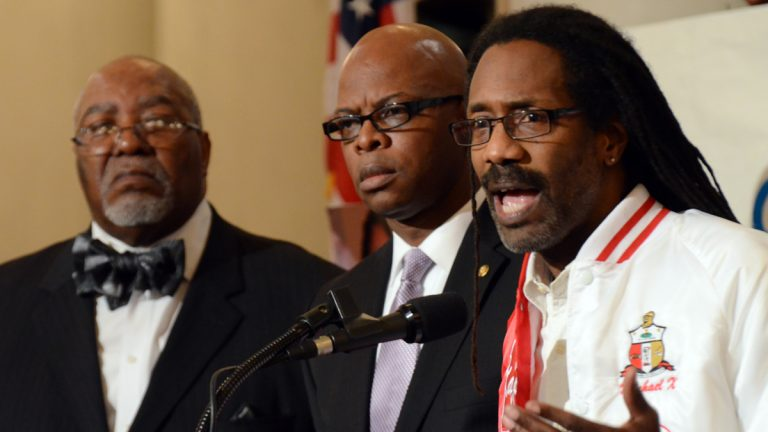 Michael Coard, a Cheyney University graduate and lawyer for a coalition suing Pennsylvania, speaks Tuesday at a rally in the Capitol Rotunda organized in an effort to press the state to help the financially struggling school. Listening are state Reps. Curtis Thomas, left, and Stephen Kinsey. (AP Photo/Marc Levy)