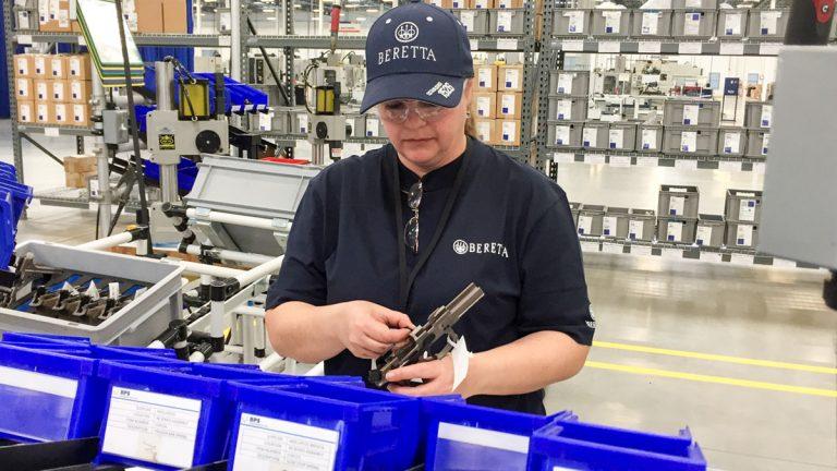 A worker assembles a handgun at the new Beretta plant in Gallatin
