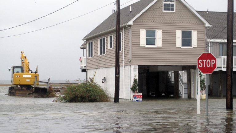 Flood waters enveloped this neighborhood in the Strathmere section of Upper Township, New Jersey, Friday. Despite forecasts showing the impending Hurricane Joaquin may move out to sea and not directly strike New Jersey, crews along the shore were nonetheless taking precautions against a wind and rainstorm. (AP Photo/Wayne Parry)