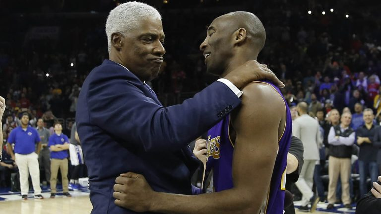 Los Angeles Lakers' Kobe Bryant, right, embraces former  76er Julius Erving ahead of a basketball game against the Philadelphia Sixers Tuesday in Philadelphia. Bryant announced his retirement Sunday. (AP Photo/Matt Slocum)