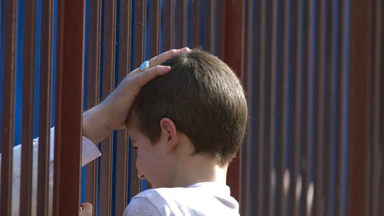Pope Francis' hand touches the head of a boy through a fence as he blesses him upon his arrival at the San Gregorio Magno parish church in Rome last year. Mayor Michael Nutter says fencing will be part of Philadelphia's crowd control measures during the papal visit (Alessandra Tarantino/ in September. (AP file photo)