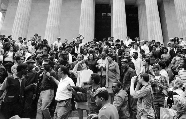 Coretta Scott King, center, is surrounded by members of the Poor People's Campaign, on the steps of the Lincoln Memorial in Washington, May 30, 1968. (AP Photo/Bob Schutz)