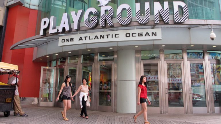 Patrons leave The Playground, developer Bart Blatstein's $52 million remake of the former Pier Shops complex, in Atlantic City. That complex opened last month, and plans for an 81,000-square-foot waterpark were approved this week as Atlantic City's efforts to recapture some of the tourism dollars it has lost to casino competition in recent years finally appear to be working. (AP Photo/Wayne Parry)