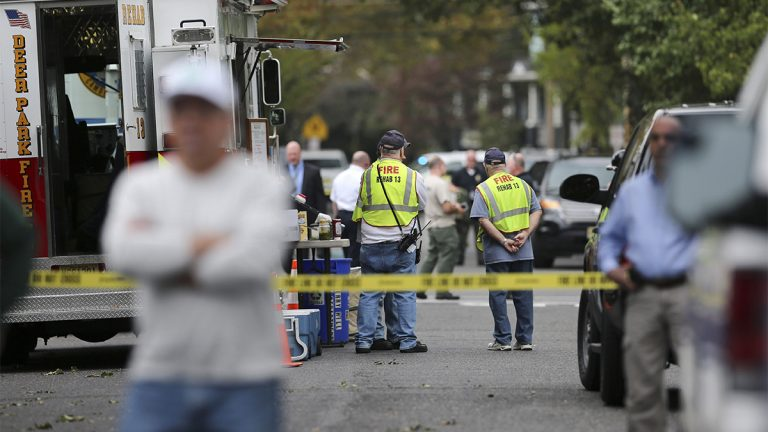 Officials gather near a small apartment building where 3-year-old  Brendan Creato was reported missing and found dead three hours later in woods several blocks from the home in October in Haddon Township, N.J. (AP Photo/Mel Evans)