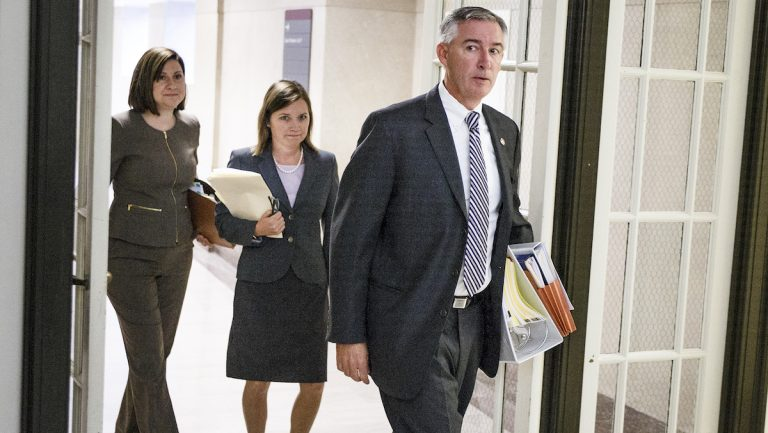 Montgomery County District Attorney Kevin Steele walks into the courtroom on the second day of Pennsylvania Attorney Kathleen Kane's trial at the Montgomery County Courthouse in Norristown