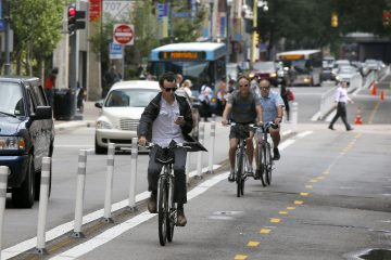 Bicyclists pedal on a bicycle-only lane on Penn Avenue in downtown Pittsburgh. (AP Photo/Keith Srakocic)