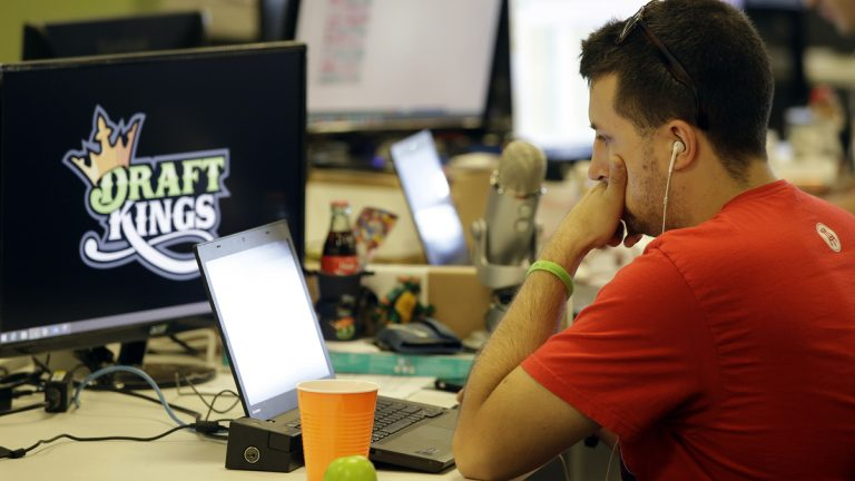 Devlin D'Zmura, a tending news manager at DraftKings, a daily fantasy sports company, works on his laptop at the company's offices in Boston. New Jersey lawmakers are trying to determine if DraftKings and other fantasy sports operations are games of skill or chance -- and whether they should be regulated. (AP photo/Stephan Savoia)