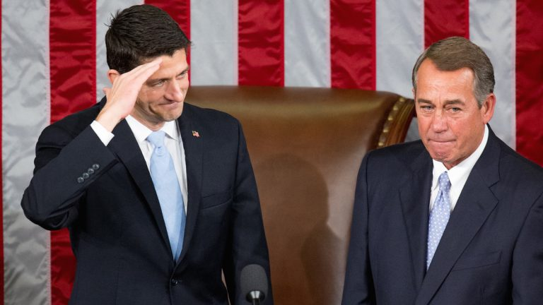 House Speaker John Boehner stands with his successor Rep. Paul Ryan, R-Wisconsin, left, in the House Chamber on Capitol Hill in Washington Thursday. Republicans rallied behind Ryan to elect him the House's 54th speaker on Thursday as a splintered GOP turned to the youthful but battle-tested lawmaker to mend its self-inflicted wounds and craft a conservative message to woo voters in next year's elections. (AP photo/Andrew Harnik)