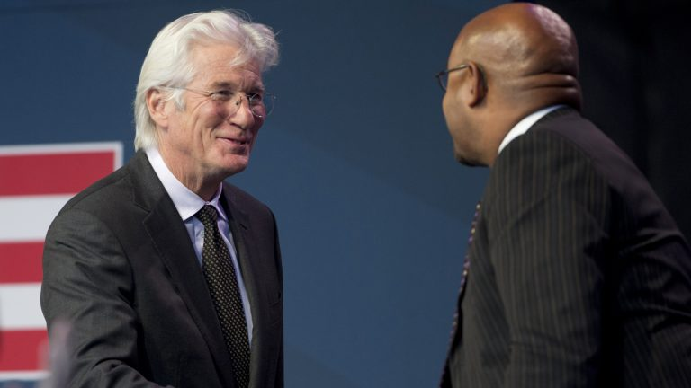 Actor, activist and philanthropist Richard Gere, left, greets Philadelphia Mayor Michael Nutter during the Liberty Medal ceremony at the National Constitution Center Monday evening in Philadelphia. The Dalai Lama, who canceled his public appearances this month because of health reasons, is this year's recipient. The honor is given annually to an individual who displays courage and conviction while striving to secure liberty for people worldwide. (AP Photo/Matt Rourke