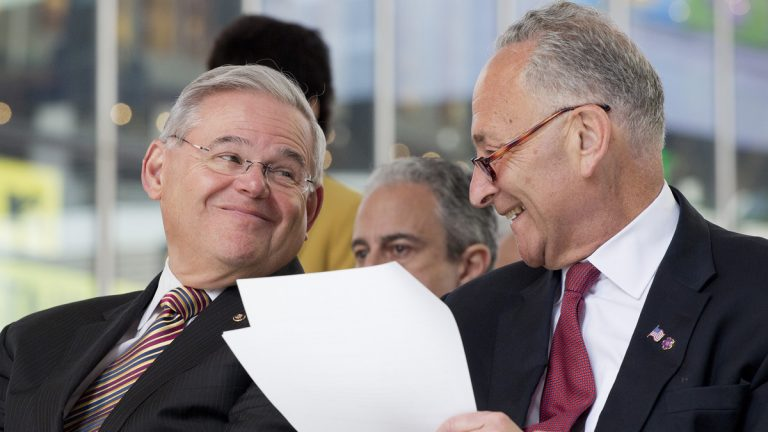 U.S. Sen Bob Menendez, left, of New Jersey speaks with U.S. Sen. Chuck Schumer of New York in April. Schumer opposes the Iran nuclear deal, while Menendez says he will decide by the end of this week. (AP file photo)
