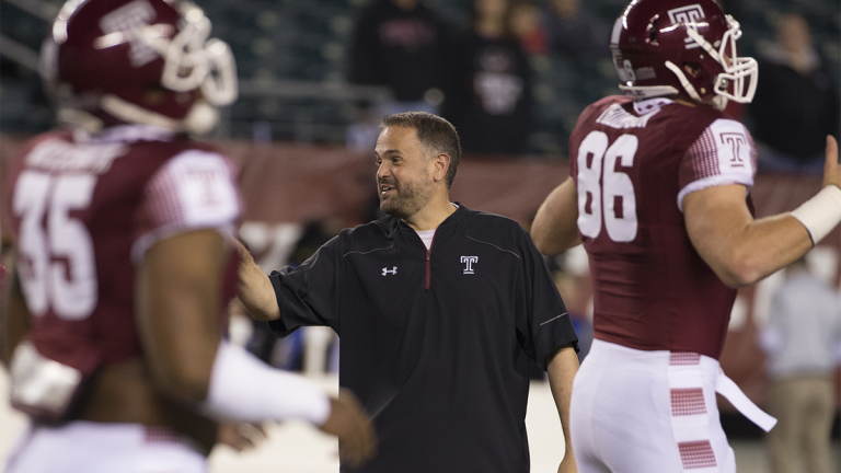 Temple head coach Matt Rhule looks over his team during warm-ups prior to the first half of an NCAA college football game against the Connecticut, Saturday, Nov. 28, 2015, in Philadelphia. Temple won 27-3. (AP Photo/Chris Szagola)