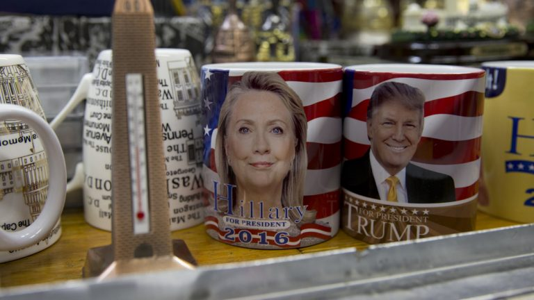 Coffee mugs for sale with the images of Democratic presidential candidate Hillary Clinton and Republican presidential candidate Donald Trump sit side by side on a shelf of a souvenir stand in Washington