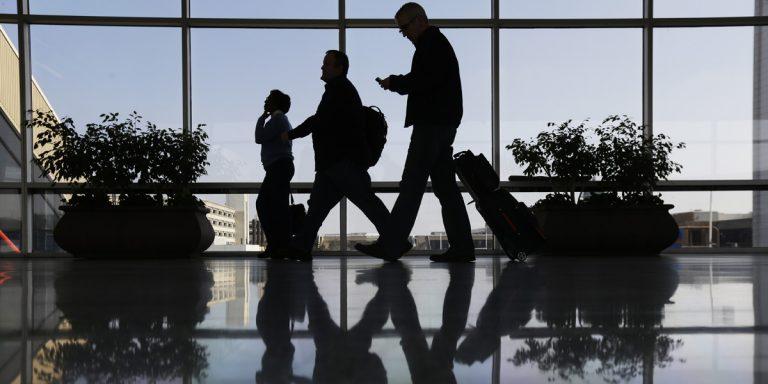 Travelers pass through a corridor at Philadelphia International Airport. (AP file photo)
