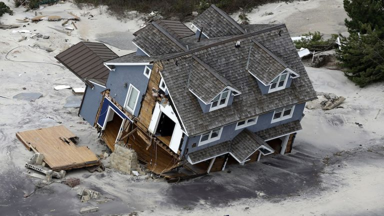 This aerial photo shows a collapsed house along the central Jersey Shore coast in October 2012. (AP Photo/Mike Groll)