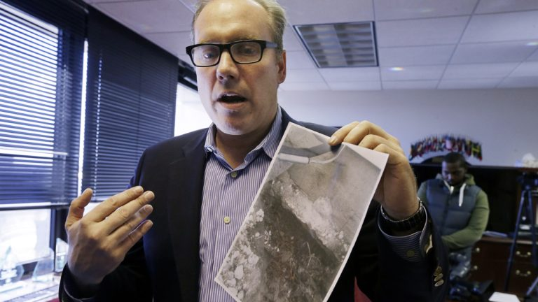 Last year, Douglas Quinn of Toms River, New Jersey, holds a photograph showing damage to his home after Superstorm Sandy. He said his insurance company contended that the damage was pre-existing and refused his claim. Homeowners in a similar situation have until Thursday to request a FEMA review of claims that have been turned down. (AP file photo)