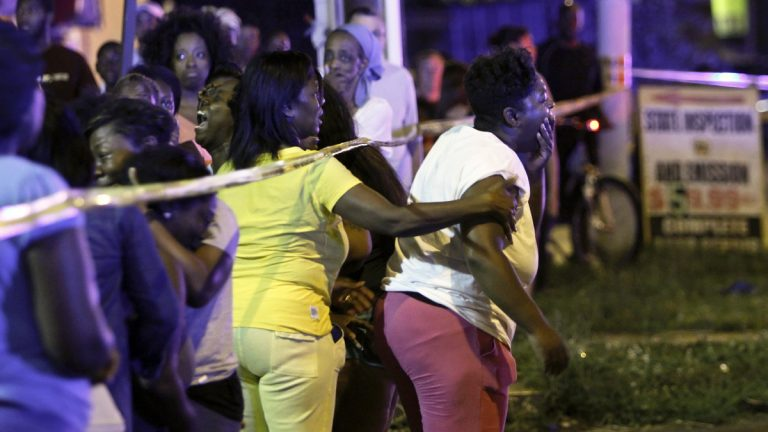 Family members react as they watch investigators at the scene of a fatal accident on Roosevelt Boulevard in the Olney section of Philadelphia on Tuesday evening July 16