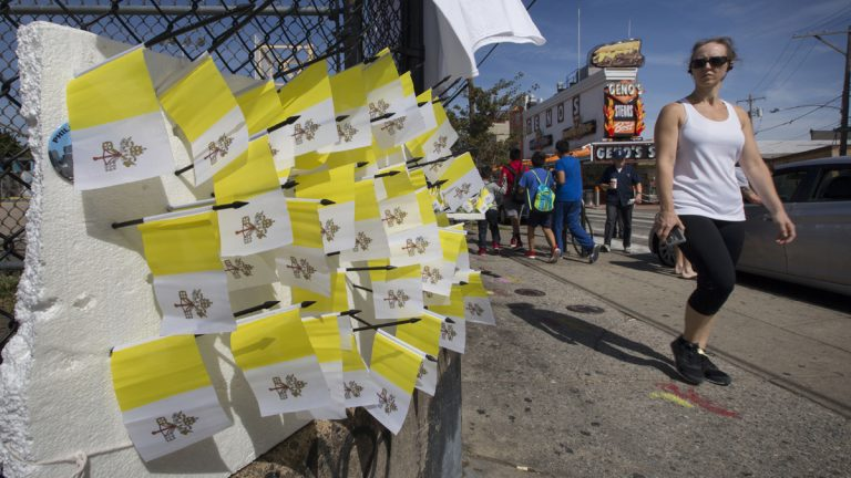 Vendors sell souvenir Vatican flags in South Philadelphia prior to Pope Francis' September visit to the city. Organizers of the Democratic National Committee Convention are finalizing  security and vending details for the event in July at the Pennsylvania Convention Center in Philadelphia. (AP Photo/Laurence Kesterson)