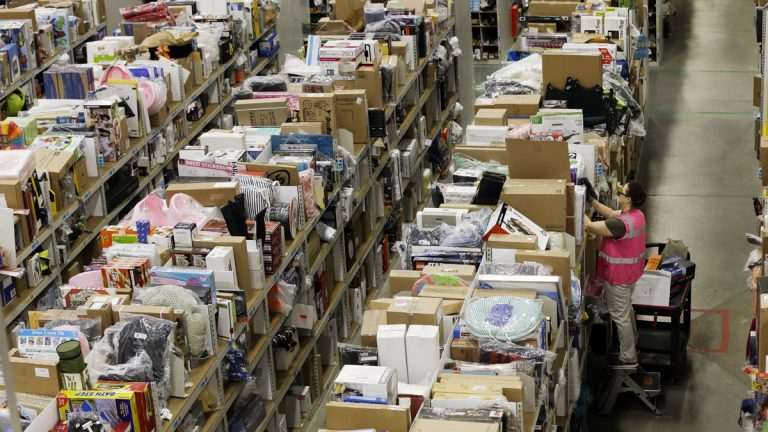 A worker fills orders at the Amazon fulfillment center on Cyber Monday last year in Lebanon, Tennessee. Cyber Monday is traditionally the busiest online shopping day of the year. (AP file photo)