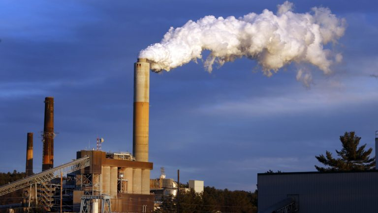 A plume of steam billows from the coal-fired Merrimack Station in Bow, New Hampshire. President Barack Obama Monday unveiled the final version of his unprecedented regulations clamping down on carbon dioxide emissions from existing U.S. power plants. The Obama administration first proposed the rule last year. Opponents plan to sue immediately to stop the rule's implementation. (AP file photo)