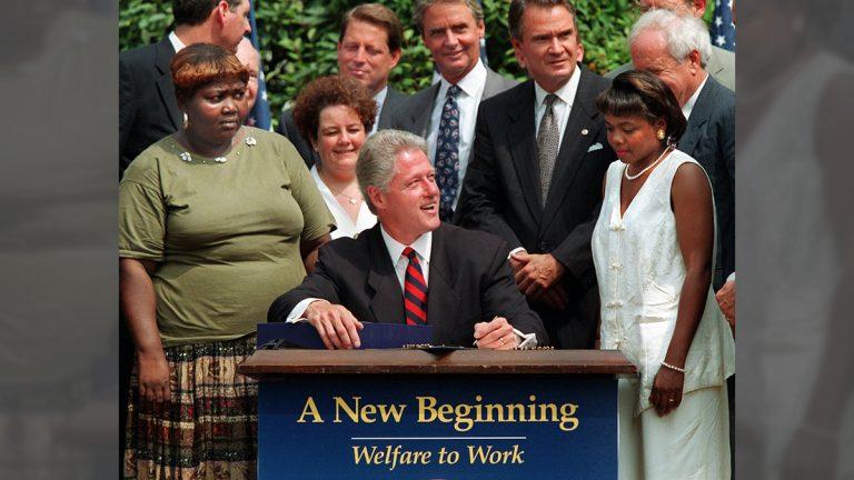 President Clinton prepares to sign legislation in the Rose Garden of the White House Thursday
