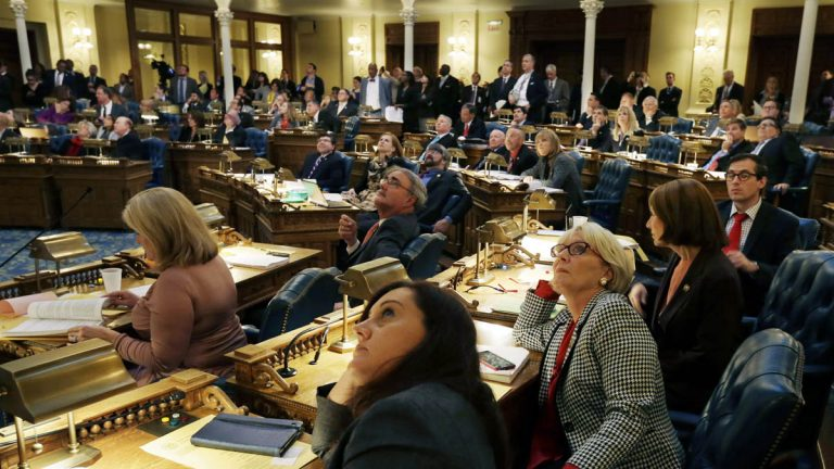 New Jersey Assembly members look up at the tally board as they vote on a veto override Thursday in Trenton, New Jersey. The Democrat-led Assembly failed in their attempt to override Gov. Chris Christie on a bill he conditionally vetoed this year. (AP Photo/Mel Evans)