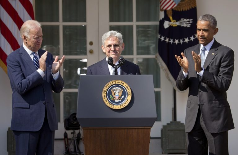 Merrick Garland is applauded by Vice President Joe Biden and President Barack Obama on either side of him