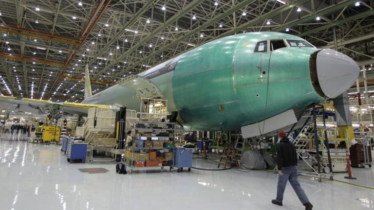 Employees cheer during a rally at Boeing Co.'s 767 assembly plant