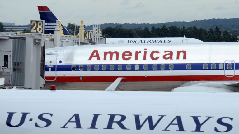 Several mayors, including Philadelphia Mayor Michael Nutter, have sent a letter to U.S. Attorney General Eric Holder urging that the Justice Department drop its opposition to the proposed $11 billion merger between US Airways Group Inc. and American Airlines' parent company, AMR Corp. (Susan Walsh/AP Photo, file)