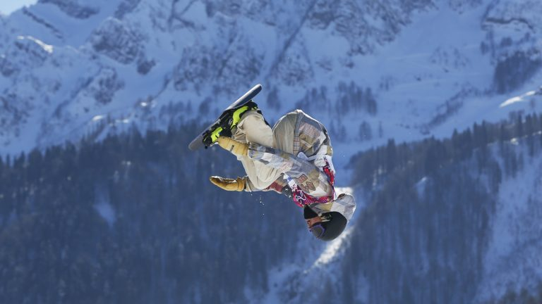 United States' Sage Kotsenburg takes a jump during the men's snowboard slopestyle final at the Rosa Khutor Extreme Park, at the 2014 Winter Olympics, Saturday, Feb. 8, 2014, in Krasnaya Polyana, Russia. (Sergei Grits/AP Photo)