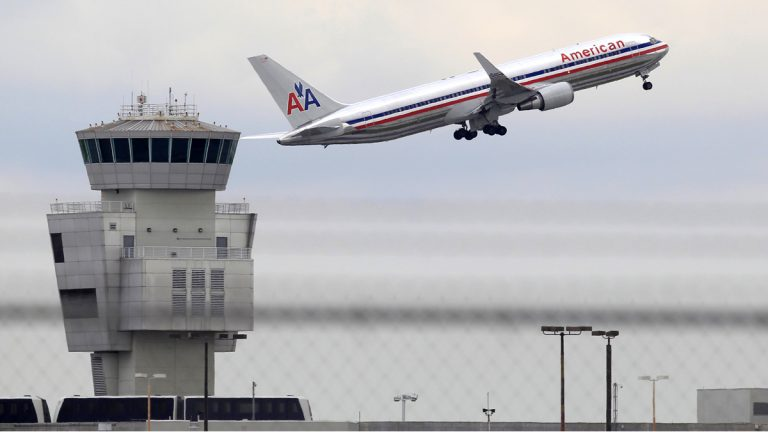 The Justice Department says it has reached an agreement to allow the merger of US Airways and American Airlines (Wilfredo Lee/AP Photo, file)