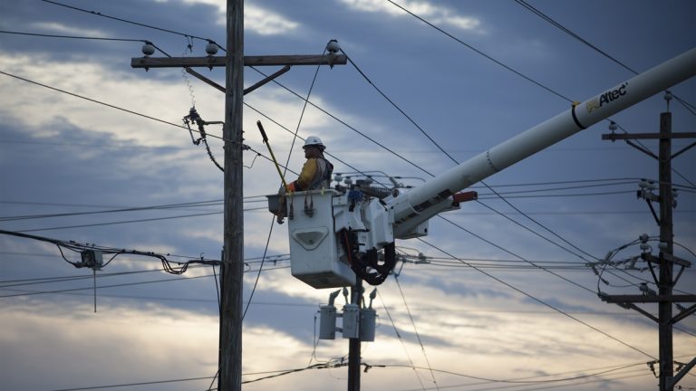 Workers work to repair power lines Friday, July 4, 2014 damaged by Hurricane Arthur. (Randall Hill/AP Photo)
