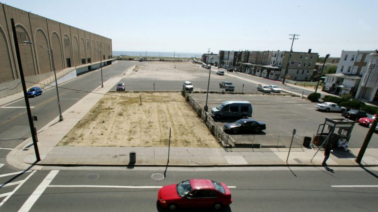 Cars drive by a vacant 2.5-acre lot in Atlantic City, N.J. (Mel Evans/AP Photo)