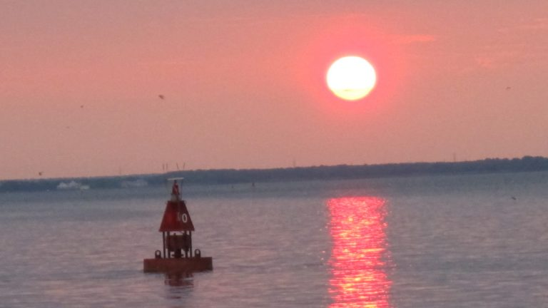 The sun sets over Barnegat Bay in this June 25, 2011 photo from Barnegat Light, N.J. (Wayne Parry/AP Photo)