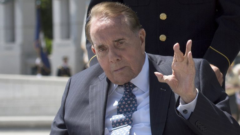 WWII veteran and former Senate Majority Leader Bob Dole waves after taking part in a wreath laying ceremony at a 10th anniversary ceremony for the WWII Memorial in Washington, Saturday, May 24, 2014. (Molly Riley/AP Photo)