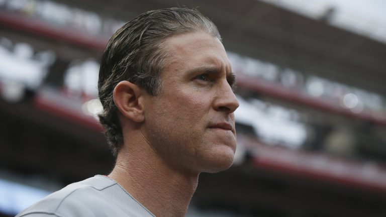 Philadelphia Phillies' Chase Utley stands in the dugout during a baseball game against the Cincinnati Reds June 9 in Cincinnati. (John Minchillo/AP Photo)