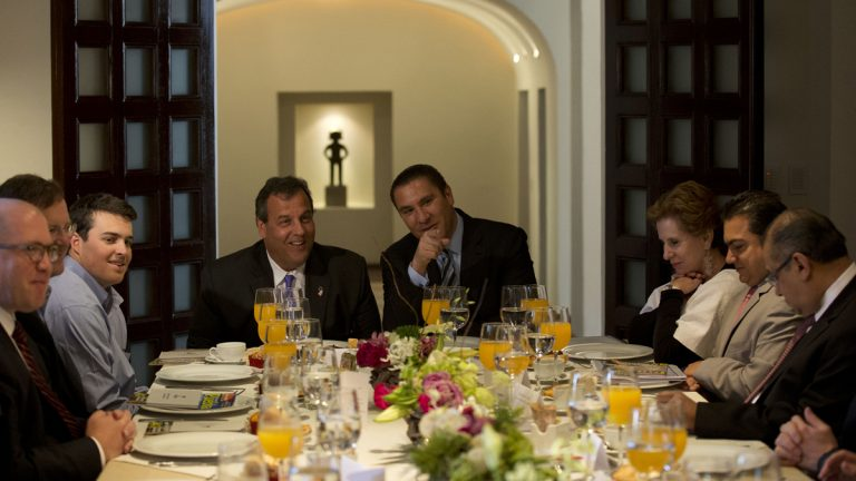 New Jersey Gov. Chris Christie, accompanied by his son Andrew, (left), talks with Puebla Gov. Rafael Moreno Valle, (center right), during breakfast at the governor's residence in Puebla, Mexico, Friday, Sept. 5, 2014. (Rebecca Blackwell/AP Photo)