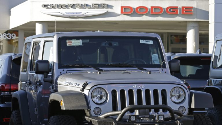 In this photo from Saturday, Nov. 7, 2015, a Jeep is seen for sale at a Chrysler / Dodge dealership (Ben Margot/AP Photo)