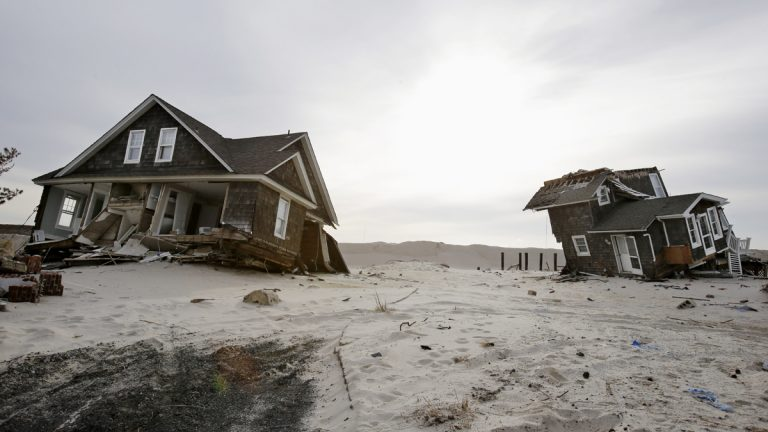 This Feb. 22, 2013 file photo shows two heavily damaged homes on the beach in Mantoloking, N.J., from Superstorm Sandy. (Mel Evans/AP Photo, file)